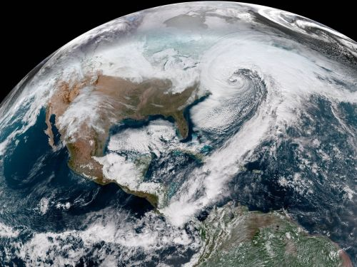 Stunning photos from space show the 'bomb cyclone' snowstorm blasting the US East Coast