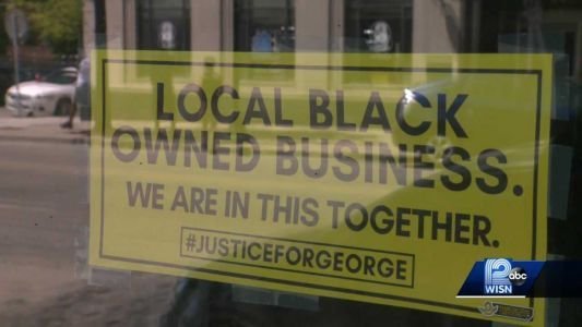 'Black-owned business' signs pop up in response to protests