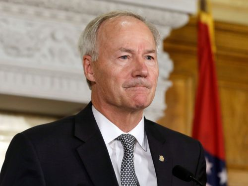 The GOP governor of Arkansas, where vaccines are lagging and COVID-19 is surging, said it's 'disappointing' vaccines are 'political'
