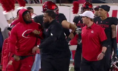 A top NFL prospect and his University of Houston coach got into a bizarre sideline confrontation over a coat