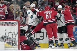 Svechnikov leads Hurricanes past Sharks 3-2 in shootout