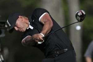 The Latest: Double bogeys galore in 4th round of PGA