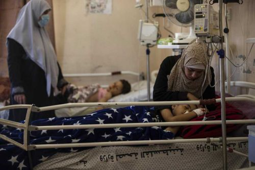 Hospitals in Gaza are struggling to handle COVID-19 cases coupled with airstrike victims