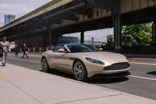 We drove a $70,000 Corvette and a $273,000 Aston Martin to see which car we liked better - here's the verdict