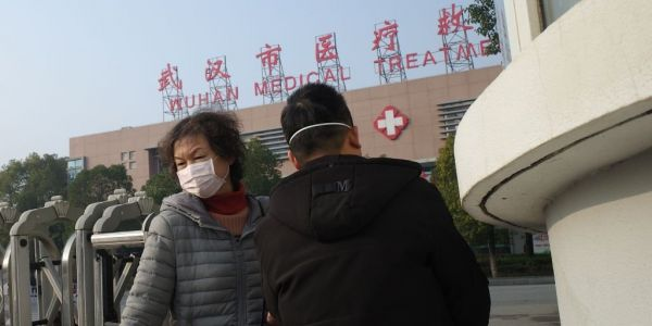 China is fighting to stop the spread of a mysterious, deadly virus as millions prepare to travel for Chinese New Year