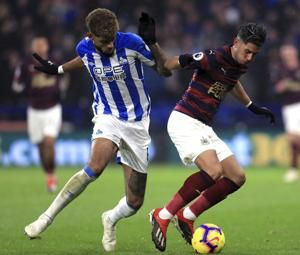 Rondon helps Newcastle end losing run at Huddersfield