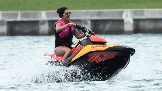 Priyanka Chopra Looks Like a Total Badass Jet-Skiing in a Tiny Black Bikini on Family Vacation