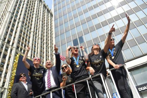 'Parades are cool. Equal pay is cooler': Thousands cheer US women's soccer team at NYC parade