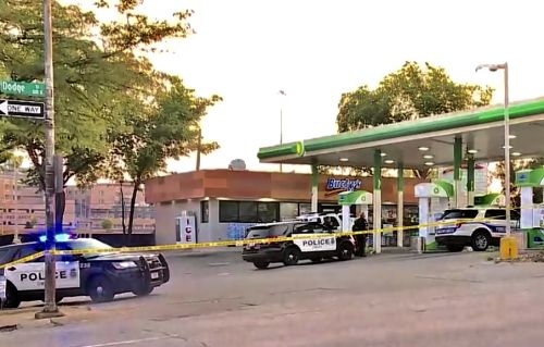 Man shot while pumping gas, suspects steal car