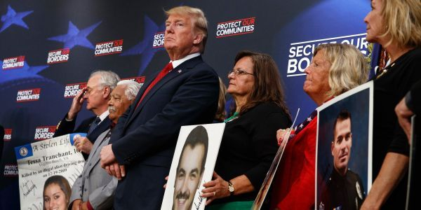Trump invited 'permanently separated' families to speak about loved ones allegedly killed by unauthorized immigrants - and he autographed posters of the victims' faces