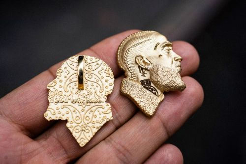 Charlamagne tha God Gives Lauren London a Greg Yuna-Designed Nipsey Hussle Pendant