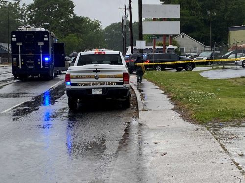 Suspect charged after man found dead with neck wound on side of road