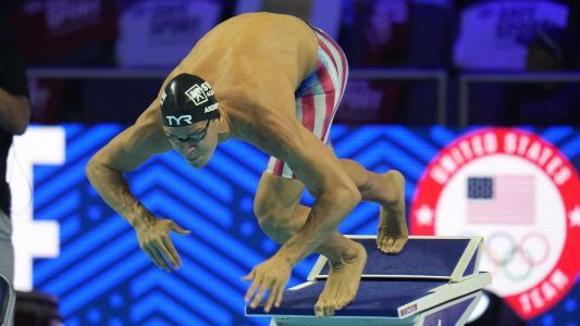 An unvaccinated US swimmer is sparking debate as the Tokyo Olympics begin