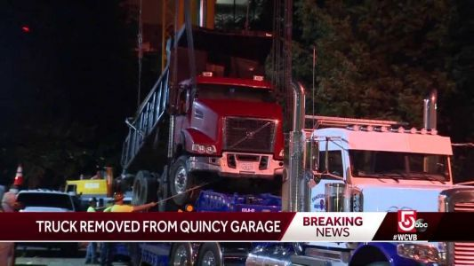 Dump truck that fell through roof removed