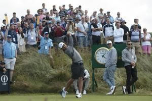 The Latest: Tee times brought forward at British Open