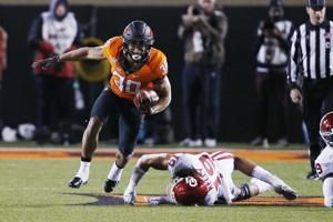 Big 12 top players are OSU RB Hubbard and Baylor DE Lynch