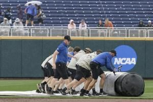 Louisville leading Auburn 4-1 in CWS game suspended by rain