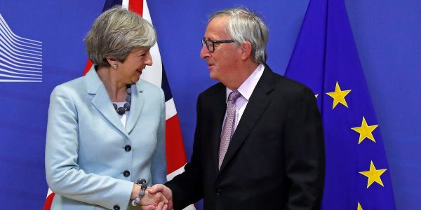 Theresa May has agreed a Brexit divorce deal after all night talks with the EU