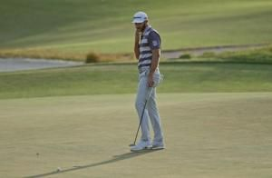 The Latest: Fleetwood ties US Open record with 63