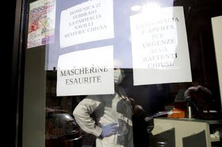 Italian towns on lockdown after 2 virus deaths, clusters