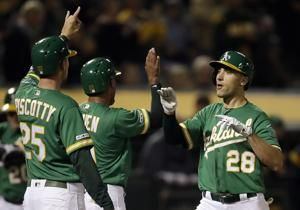 Olson, Canha go back-to-back in A's 6-2 win over Mariners
