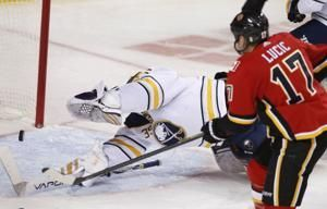 Lucic scores 1st goal with Flames in 4-3 win over Sabres