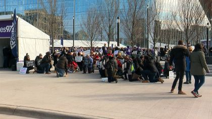 Protesters 'Take A Knee' At U.S. Bank Stadium To Rally Against Police Violence