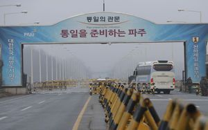 The Latest: Koreas consider Olympic march under joint flag