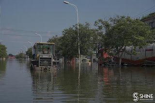 Flood waters still pose a threat for many villages in Henan