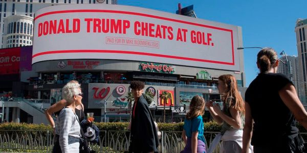 Mike Bloomberg is going after Trump with billboards mocking him for eating 'burnt' steak and cheating at golf