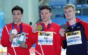 Xie wins 3-meter springboard gold after Laugher falters