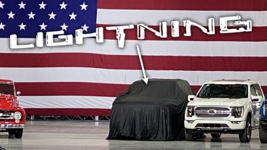 Here's A Sneak Peek At Ford's Electric F-150 Lightning Waiting For The President Under A Sheet
