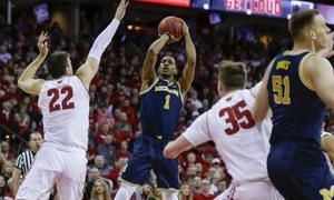 Happ, Wisconsin hand No. 2 Michigan its first loss, 64-54