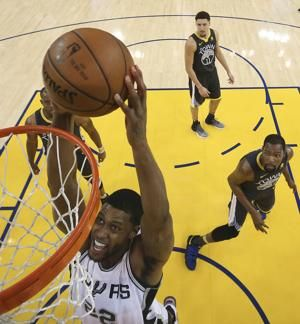 The Latest: Warriors beat Spurs 110-97