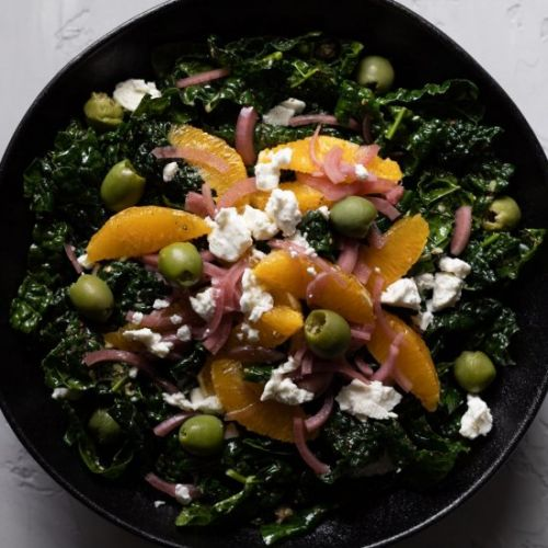 Greek salad with oranges and kale