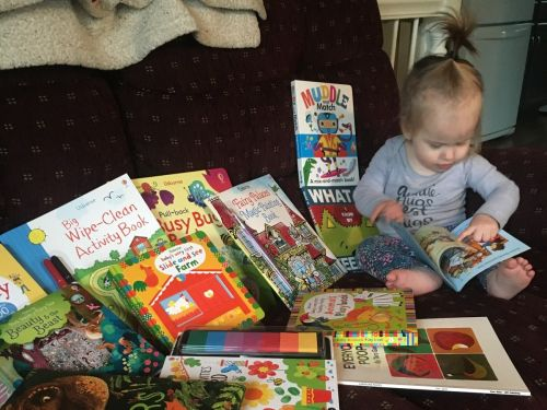 My 1-year-old daughter is obsessed with these books - they keep her entertained longer than any toy