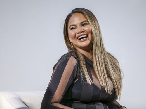 Chrissy Teigen used a breast pump on the way to a fancy dinner because being a mom is a full-time job