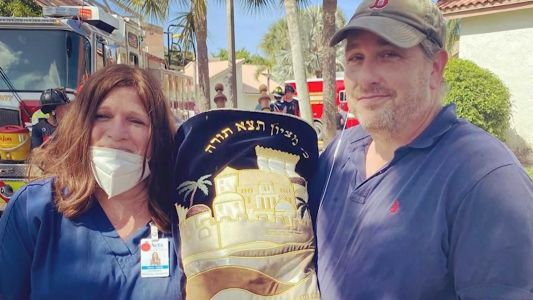 Family's 100-year-old Torah survives house fire
