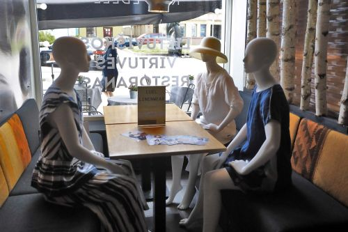 Lithuania restaurants using mannequins at empty tables to model local designers' fashions