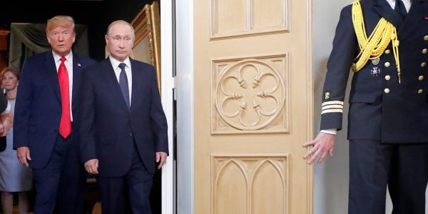 Man holding apparent protest sign removed from room right before Trump and Putin held joint press conference