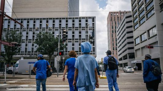 Some workers are pushing back against hospitals requiring COVID-19 vaccines