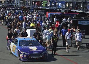 The Latest: Truex takes early lead from Larson in Sonoma