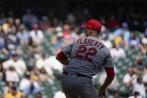 Flaherty's 7th wins lifts Cards as Burnes walks 1st batter
