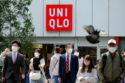 UNIQLO's Recycling Program Is Giving Customers Digital Cash Coupons in Exchange for Used Clothes