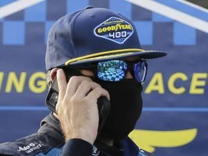 The Latest: NASCAR lifting mask mandate in garage, pits