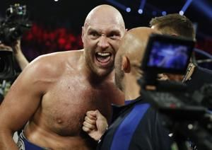 Tyson Fury stays unbeaten, stops Tom Schwarz late 2nd round