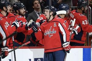 Carlson leads Caps to first home win, 4-3 over Maple Leafs