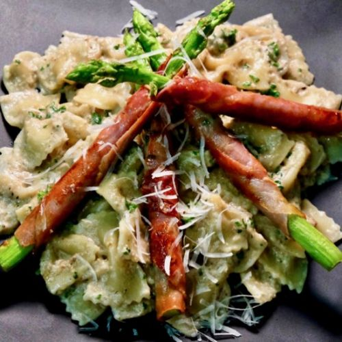 Speck wrapped asparagus on pasta