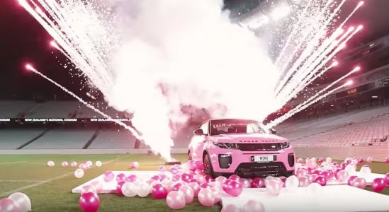 An Instagram-famous personal trainer hired a helicopter and an entire stadium to propose to his girlfriend with a pink Range Rover and giant diamond ring