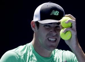 Isner upset by Opelka in 4 tiebreakers at Australian Open